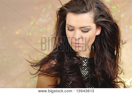 Beautiful sexy woman portrait over gold background
