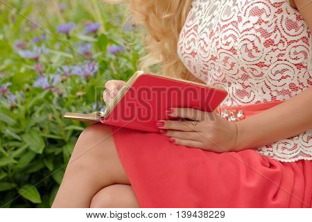 Woman with a notebook on her knees