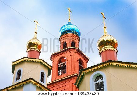 Bright Domes Of The Orthodox Church Against The Clear Blue Sky
