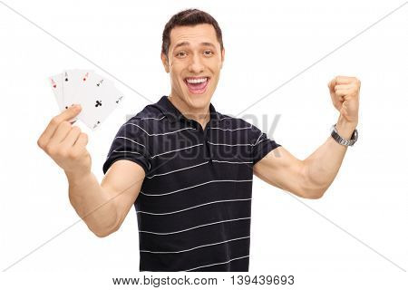 Lucky young man holding four aces in his hand and gesturing happiness isolated on white background