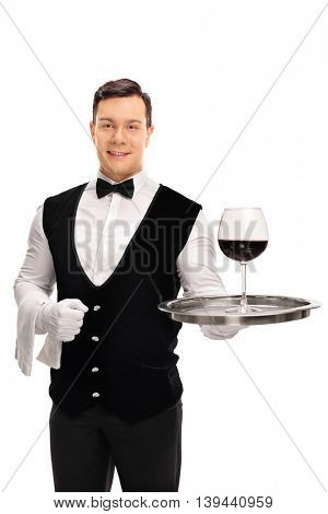 Vertical shot of a male waiter holding a tray with a glass of red wine on it isolated on white background