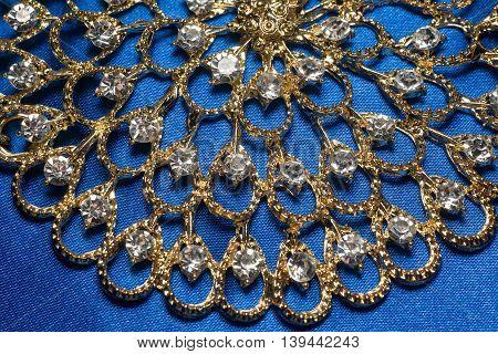 Golden Necklace On Blue Background