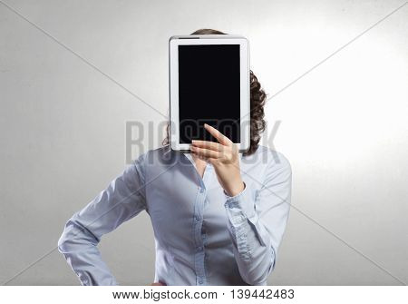 Woman use tablet device .  Mixed media
