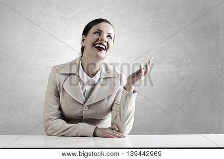 Attractive businesswoman having mobile conversation .  Mixed media