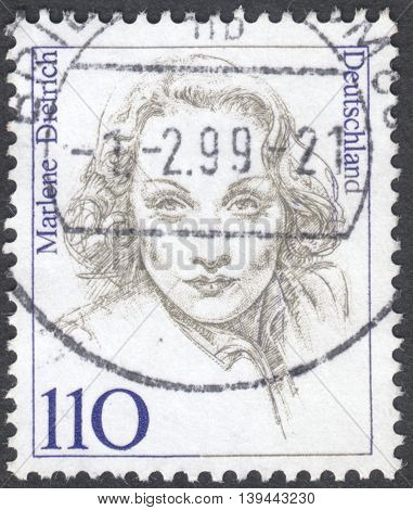MOSCOW RUSSIA - CIRCA JANUARY 2016: a post stamp printed in GERMANY shows a portrait of Marlene Dietrich the series