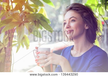 Woman In Interior Holfing A Cup Of Coffe In Hands