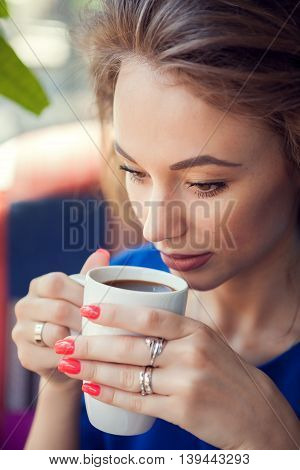 Woman Drinking Coffee In Close Up Portrait