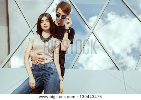 Couple Posing Cool In Front Of Office Building