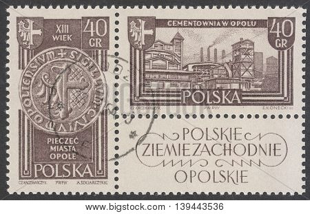 MOSCOW RUSSIA - CIRCA JANUARY 2016: a post stamp printed in POLAND shows Opole town and Cement works in Opole the series
