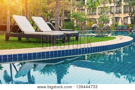 Pool Bed Near Swimming Pool In Tropical Resort
