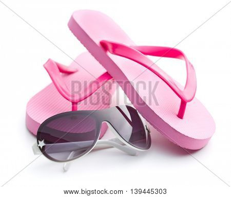Flip flops and sunglasses isolated on white background.