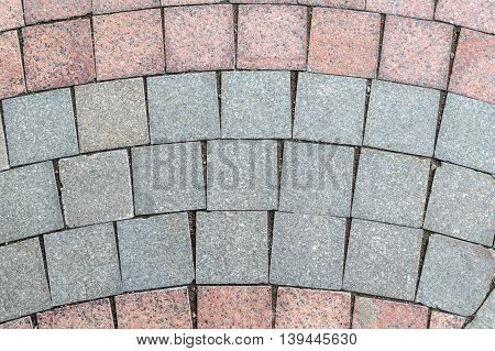 Detail of the pavement lined with ceramic granite square tiles