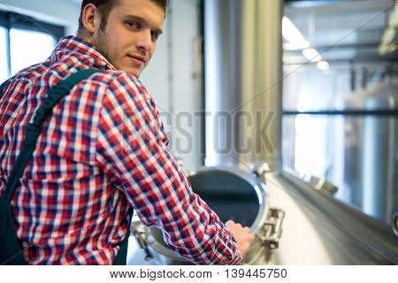 Portrait of maintenance worker working at brewery