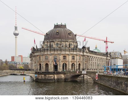 BERLIN GERMANY - APRIL 4 2016: famous Bode Museum with Berlin TV Tower in background Berlin Germany