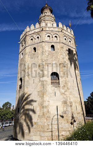 SEVILLE, SPAIN - September 13, 2015: The Torre del Oro (Tower of the Gold) is a dodecagonal military watchtower on September 13, 2015 in Seville, Spain