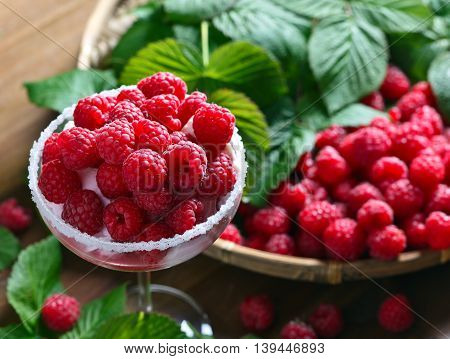 raspberry dessert with ripe juicy berries, focus on foreground