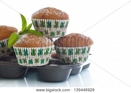 sweet baked muffins with jam inside on a white background
