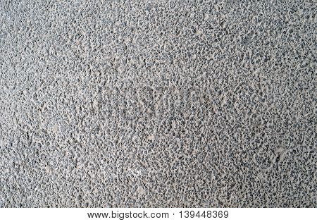 Plastered concrete surface with an uneven rough texture