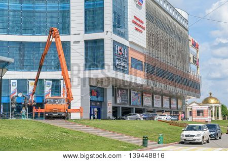 Orel, Russia - June 23, 2016: Lift mounted on truck near the building of the Congress Hall