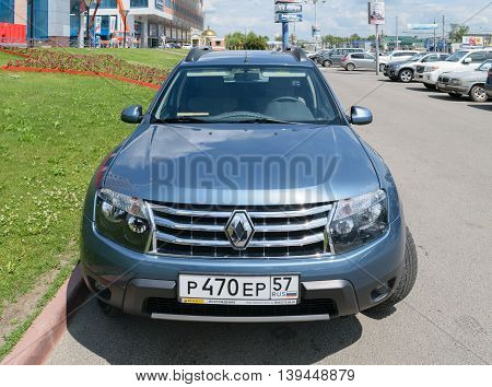 Orel, Russia - June 23, 2016: Front view of a blue passenger car Renault Duster parked near the business center