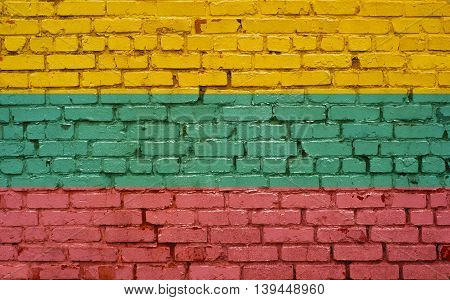 Flag of Lithuania painted on brick wall background texture