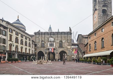 Bergamo Italy - February 23 2016: piazza vecchia old square in the upper city and Ragione Palace which was the seat of the administration of the city in the age of the communes.
