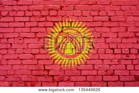 Flag of Kyrgyzstan painted on brick wall background texture
