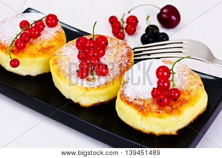 Cheesecakes with Chocolate and Red Currant Studio Photo