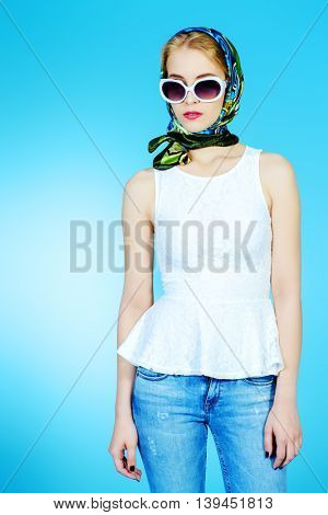 Elegant young woman in sunglasses and headscarf. Beauty, fashion.