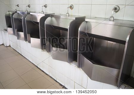 Urinal at public filling station in Thailand.
