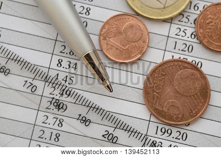Financial background with money ruler table and pen.