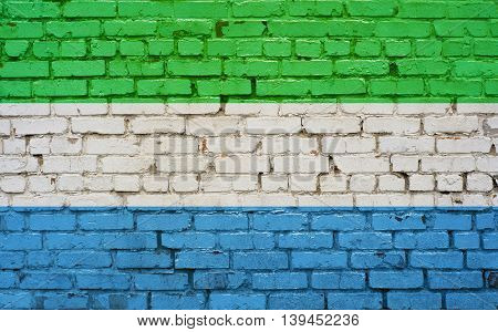 Flag of Sierra Leone painted on brick wall background texture