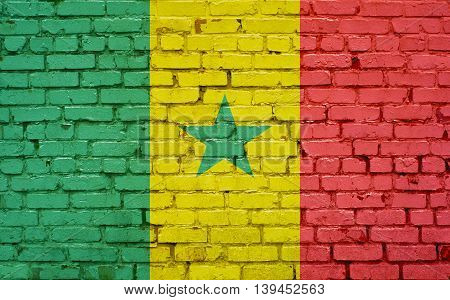 Flag of Senegal painted on brick wall background texture