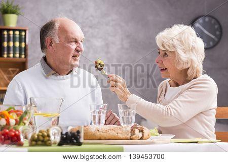 Woman Feeding Her Husband