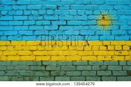 Flag of Rwanda painted on brick wall background texture