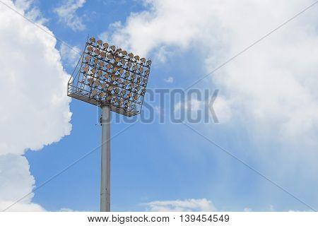 Spot-light tower of stadium on blue sky background