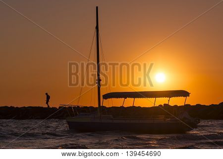 Boat and sunrise. Fishing boat in sunrise. Fisherman boat in sunrise. Sunrise boat.