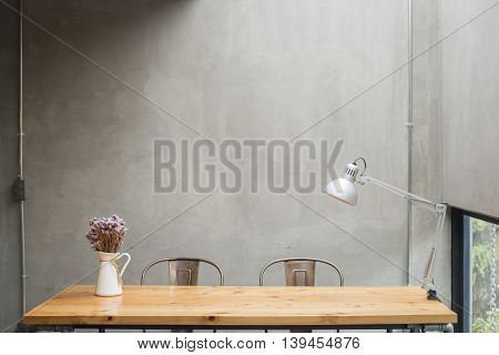 Beautiful Modern desks with cement wall background