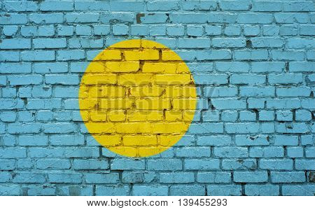 Flag of Palau painted on brick wall background texture