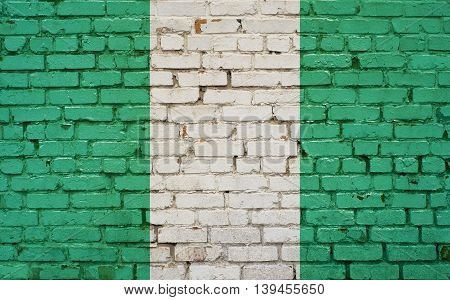 Flag of Nigeria painted on brick wall background texture