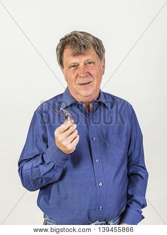 Gesturing Mature Man In Studio Isolated On White
