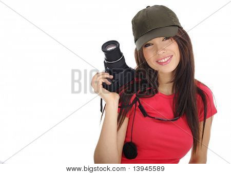 Young beautiful woman holding a photo camera. Isolated over white background
