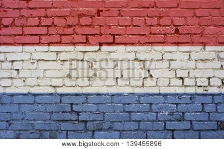 Flag of Netherlands painted on brick wall background texture