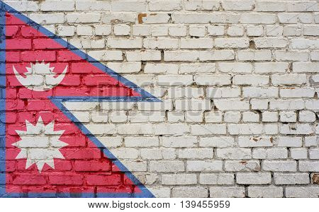 Flag of Nepal painted on brick wall background texture