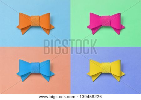 Artificial leather bow on a colorful background