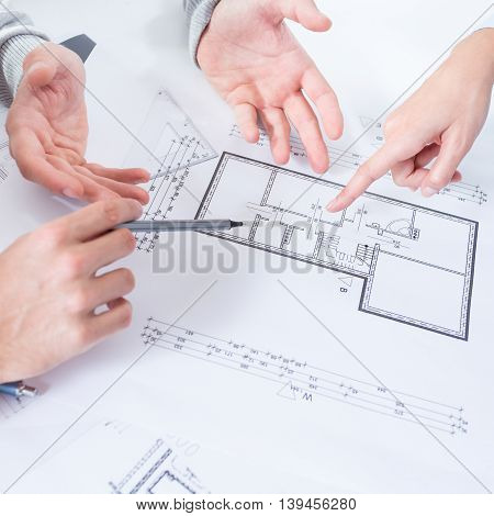 Employees discussing  architect project in the office