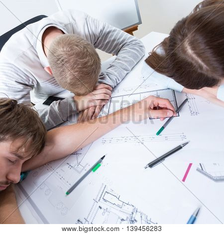 Exhausted architects fell asleep while working about project