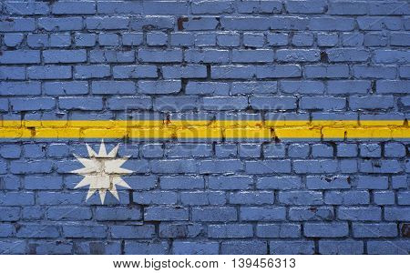 Flag of Nauru painted on brick wall background texture
