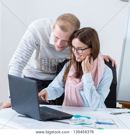 Young Couple Working In Office