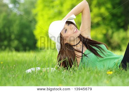 Portrait of sexy woman on park background